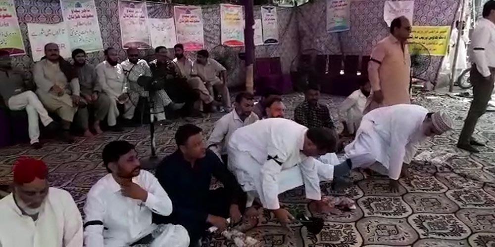Trade association hunger strike camp khi